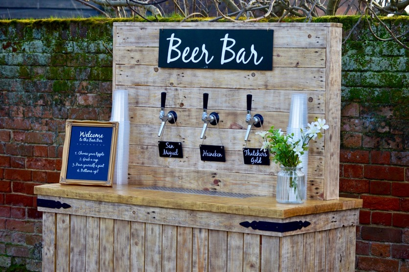 Self serve beer bar at a rustic country wedding