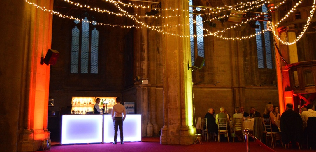 Mobile bar with LED lighting serving drinks at a wedding
